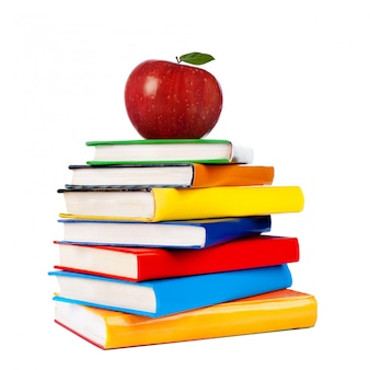 Books tower with apple isolated on white