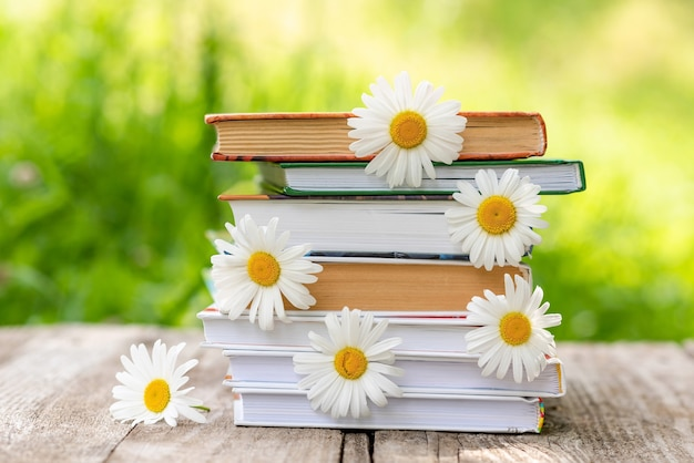 Books with daisies between the pages.