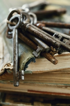 Books with old rusty keys