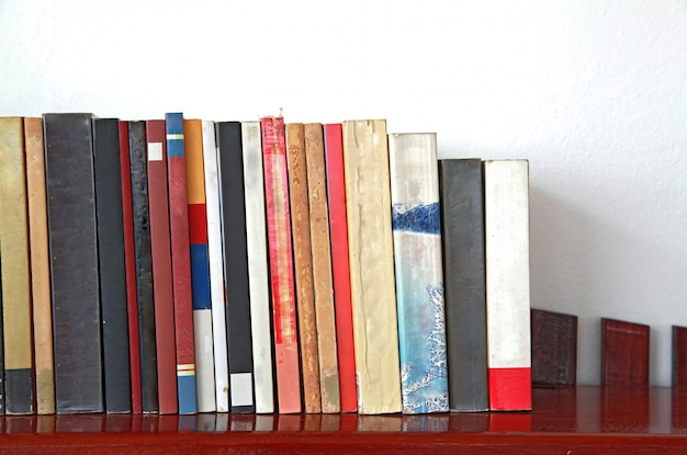 Books on wooden bookshelf