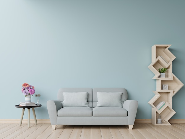 Bookshelf in living room have sofa and blue wall