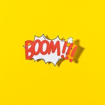 Boom cartoon illustration text in retro pop art style on yellow background