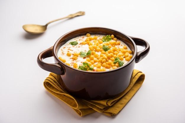 Boondi raita is a north indian side dish variety made with spiced yogurt and boondi or crisp fried gram flour balls