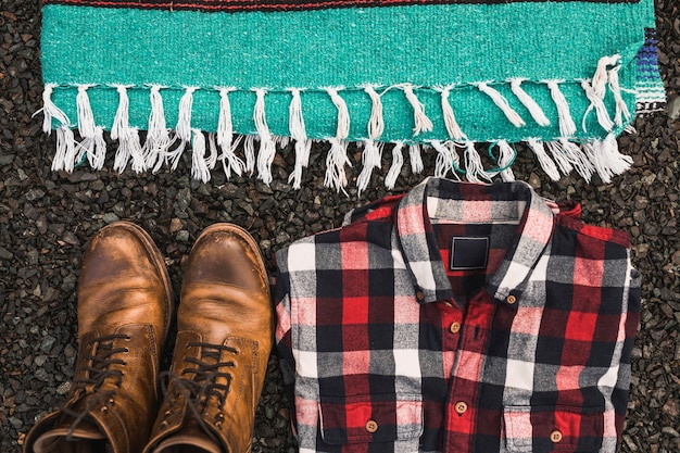 Boots and shirt near blanket