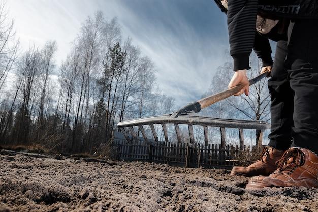 Boots and shovel closeup