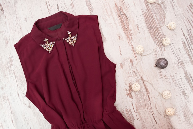 Bordeaux dress, rhinestones on the collar.