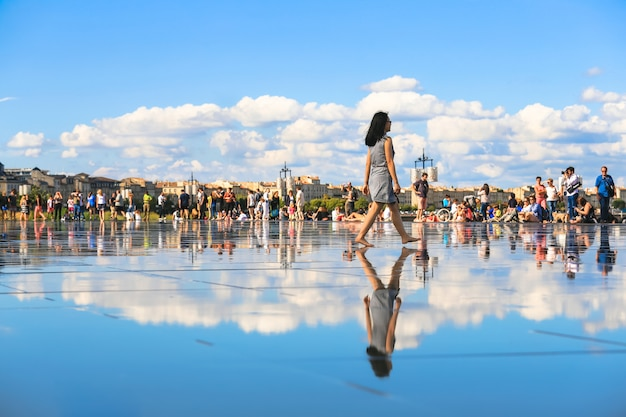 Bordeaux water mirror full of people in one of the hotest summer day, having fun in the water, the pool is the largest water mirror in the world
