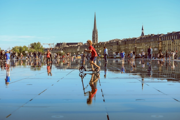 Bordeaux water mirror full of people in one of the hotest summer day, having fun in the water