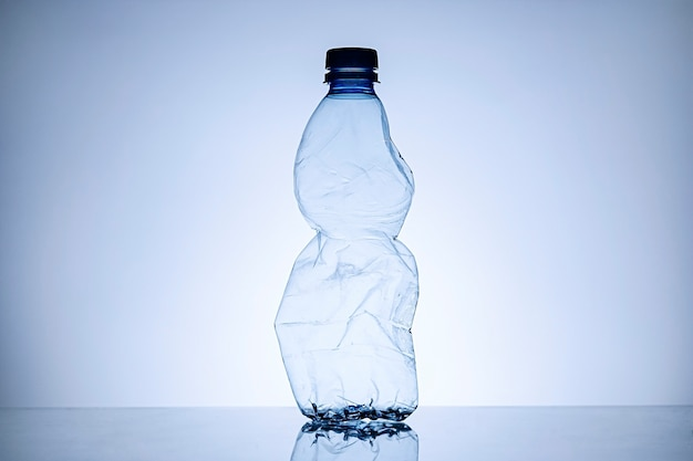 Border of a crumpled empty clear plastic bottle