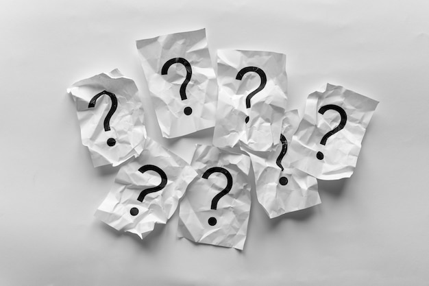 Border of crumpled question marks on cards