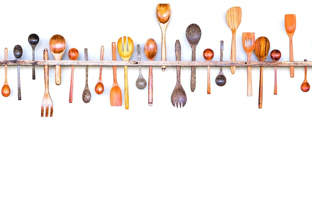 Border frame of collection set and different wooden spoons in spoon scoop