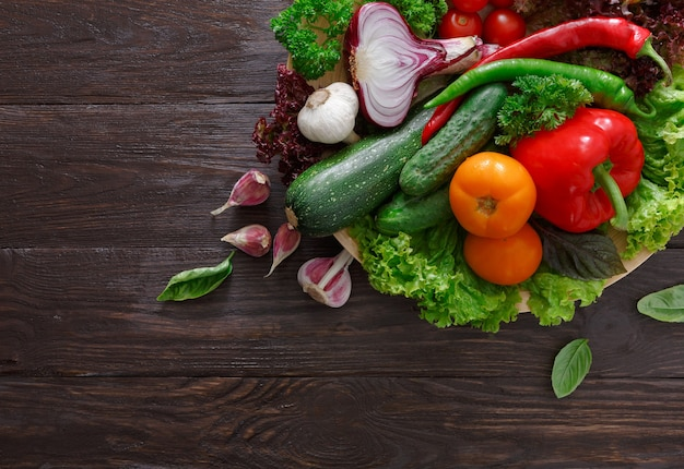 Border of fresh vegetables on wood with copy space