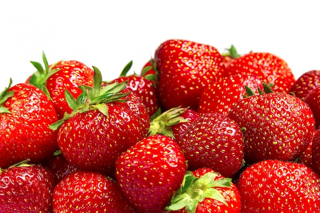 Border from organic strawberries on top side on white background, mockup for text.