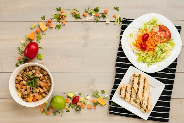 Border made of healthy food ready meal and vegetable pieces