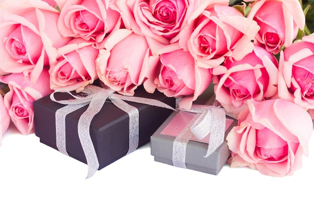 Border  of  pink garden roses with gift boxes  isolated on white background