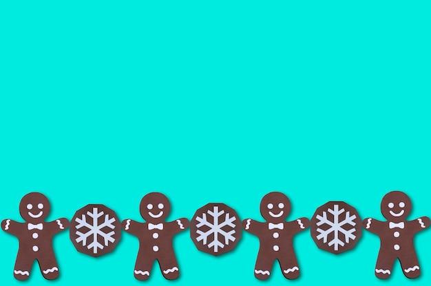 Border of volumetric handmade paper gingerbread men and chocolate cookiesfor christmas decor