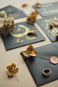 Border of wedding craft envelopes on black table