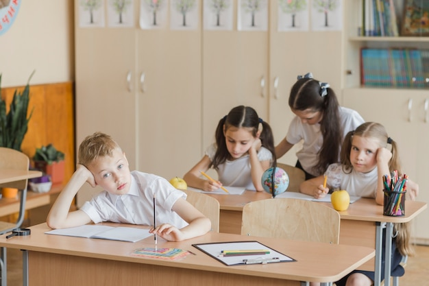 Bored kids sitting in classroom