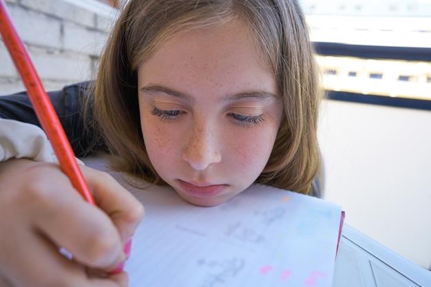 Bored student girl doing her homework
