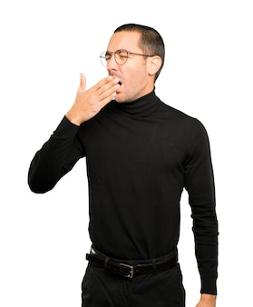 Bored young man yawning gesture