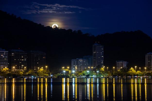 Born of the full moon, in lagoon rodrigo de freitas in rio de janeiro.