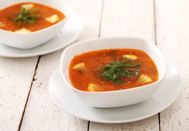 Borsch soup in white dishes