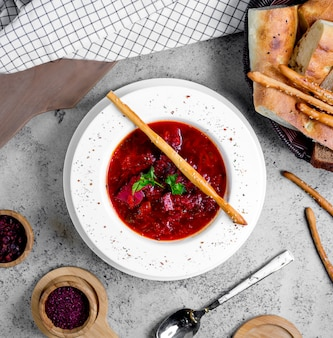 Borsch with herbs and cracker on top