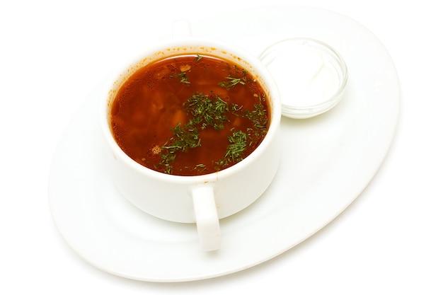 Borscht soup and sour cream, russian cuisine