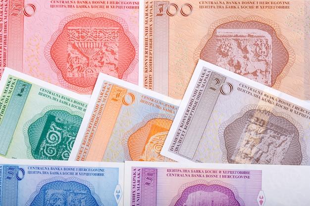 Деньги боснии и герцеговины - конвертируемые марки на фоне бизнеса