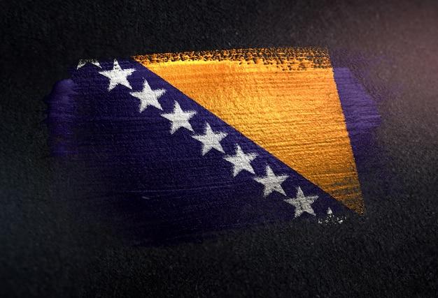 Bosnia and herzegovina flag made of metallic brush paint on grunge dark wall