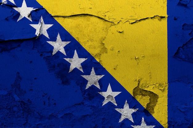 Bosnia and herzegovina flag painted on grunge cracked wall