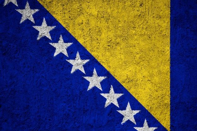 Bosnia and herzegovina flag painted on grunge wall