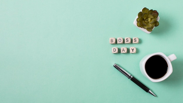 Boss's day arrangement on light blue background with copy space