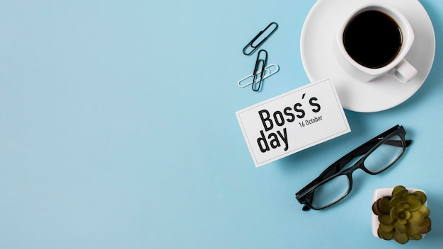 Boss's day assortment on blue background with copy space