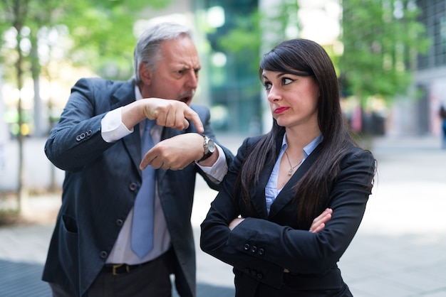 Boss scolding an employee for being late