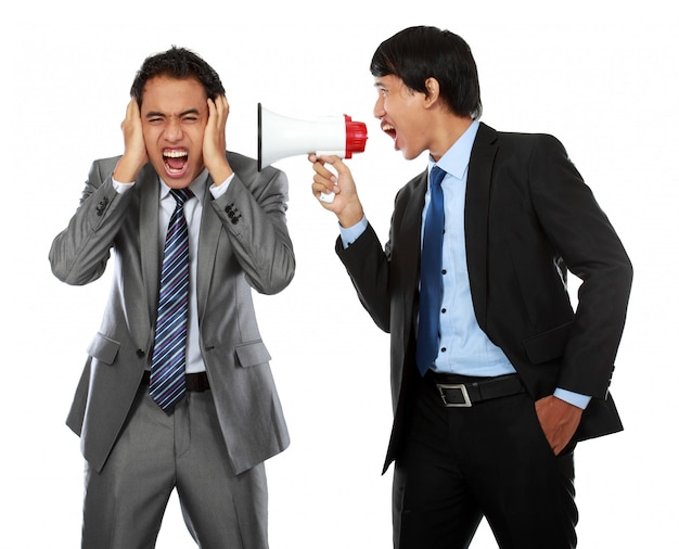 Boss shouting over his employee's ear