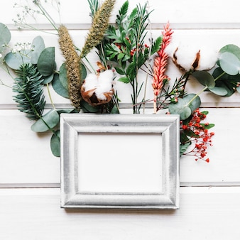 Botanical composition with frame Free Photo