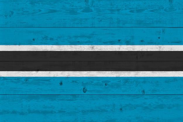 Botswana flag painted on old wood plank