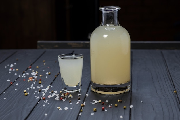 Бутылка и стакан самогона