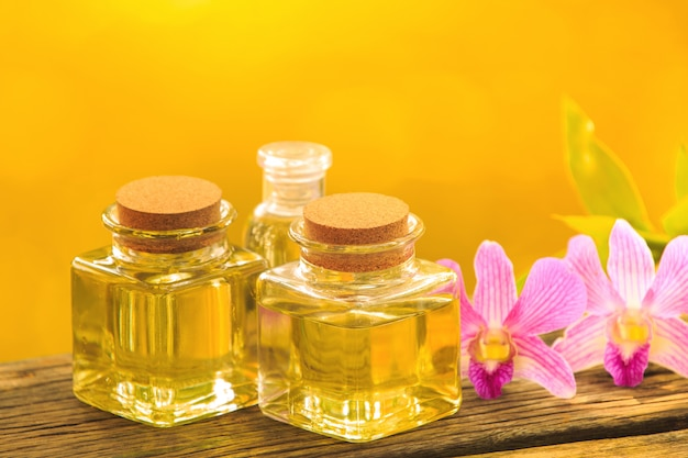 Bottle of aroma essential oil or spa on wooden table,