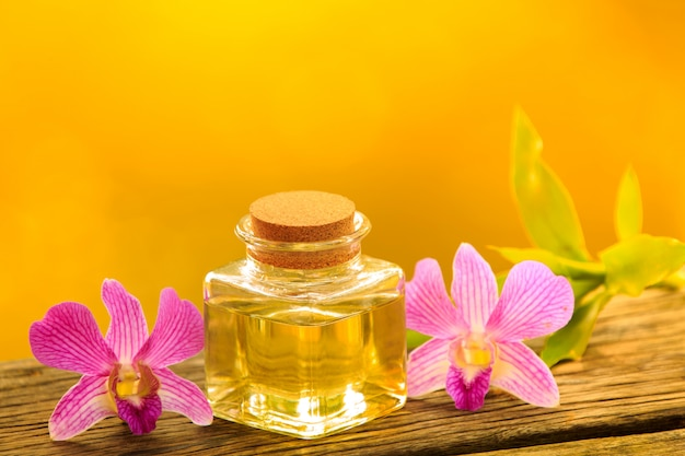 Bottle of aroma essential oil or spa on wooden table