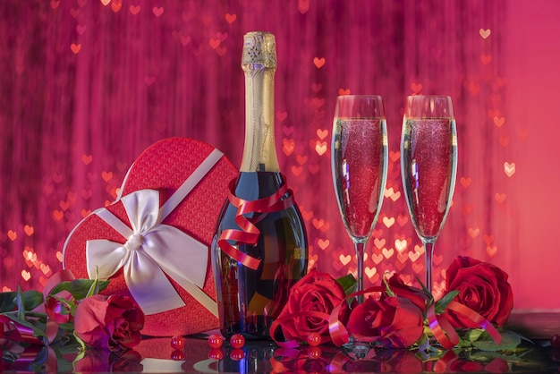 Bottle and beautiful glasses with sparkling wine luxurious gift box in shape