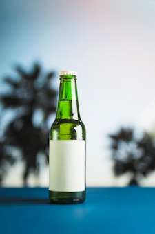 Bottle of beer on blue table