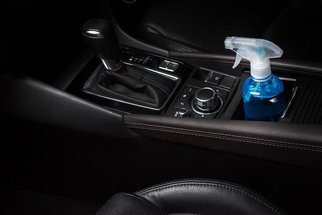 Bottle of blue ethyl alcohol hand gel cleanser put in car prepare for protect coronavirus covid19