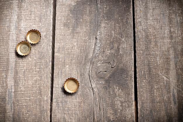 Bottle caps on rustic wooden