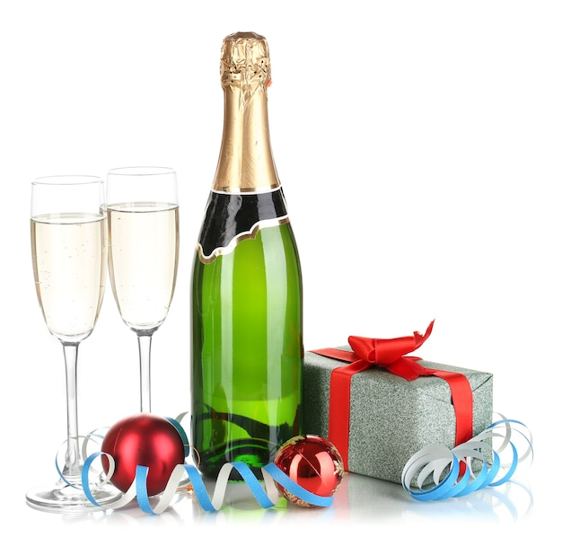 Bottle of champagne with glasses and christmas balls isolated on white