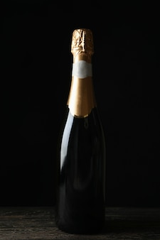 Bottle of champagne on wooden table