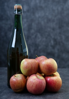 Bottle of cider and beautiful organic apples