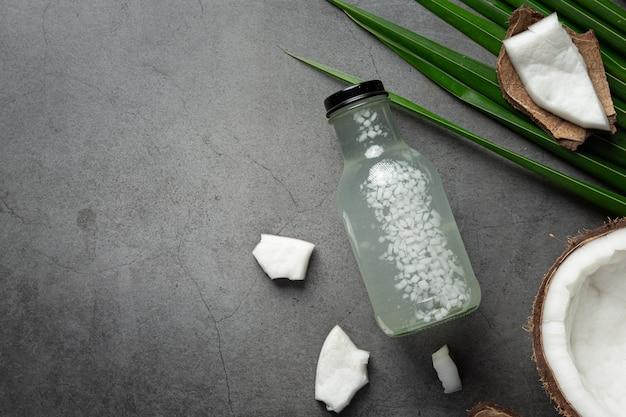 Bottle of coconut water put on dark background