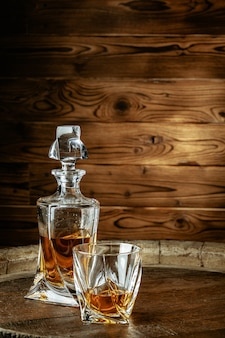 A bottle of cognac and glass. brandy